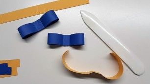 gift bow toppers - using bone folder 2